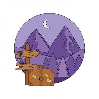 スーツケースと木製の矢印ガイドラベル