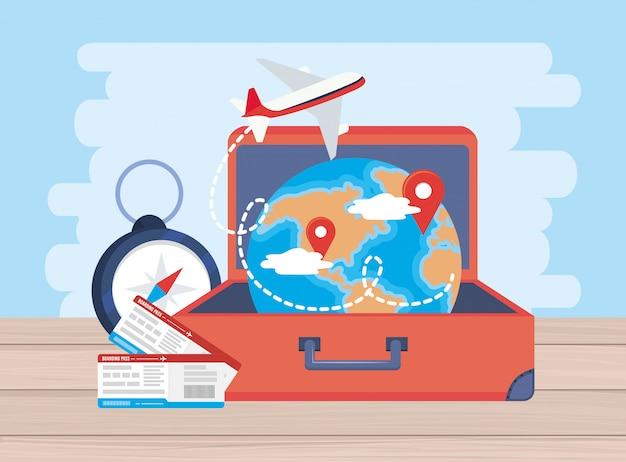 荷物の内部チケットと世界地図の場所で飛行機