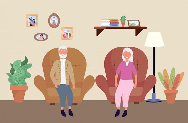 Старая женщина и мужчина в кресле с растениями