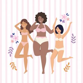 Счастливые девушки в нижнем белье с цветами и растениями