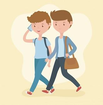 スマートフォンを使用して歩く若い男の子