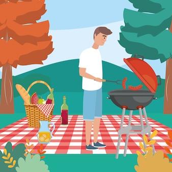 Человек с жареной колбасой и в скатерть с едой