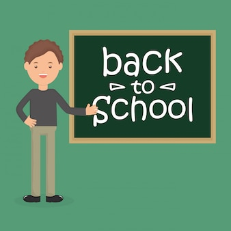 黒板を持つ若い男性教師。学校に戻る