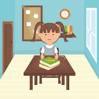 教室でかわいい小さな学生の女の子