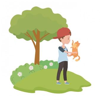 猫の漫画を持つ少年
