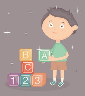 ブロックのアルファベットのおもちゃで遊ぶ少年