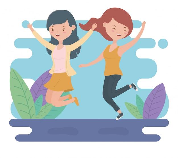 Счастливые молодые женщины празднуют прыжки в поле