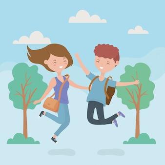 幸せなカップルの森のシーンでジャンプを祝う