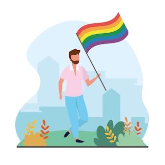 自由のパレードに虹色の旗を持つ男