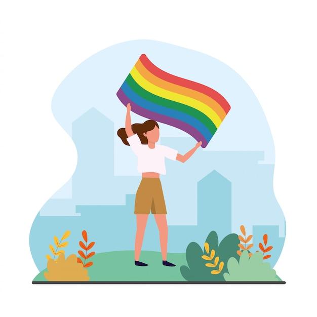 自由のパレードに虹色の旗を持つ女性