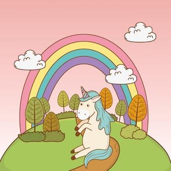 フィールドに虹とかわいいおとぎ話ユニコーン