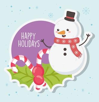 スカーフとキャンディー杖メリークリスマスとかわいい雪だるま