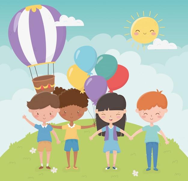 幸せな子供の日、手を繋いでいる子供風船熱気球公園