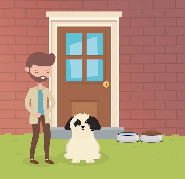 Человек с собакой сидит в саду дома по уходу за домашними животными
