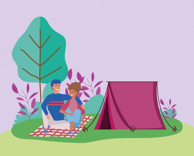 カップルに座って毛布ピクニックアウトドアシーン