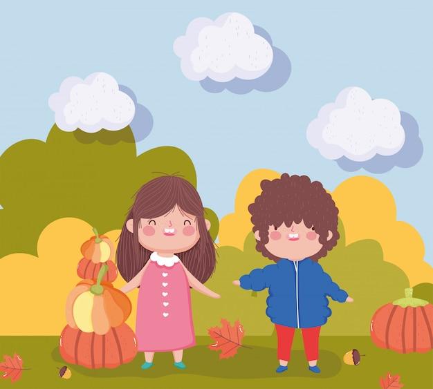 男の子と屋外でカボチャを持つ少女