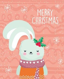 スカーフとヒイラギの果実とメリークリスマスのお祝いかわいいウサギ