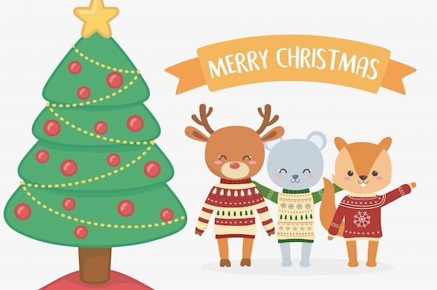 メリークリスマスのお祝いクマリスと鹿の木