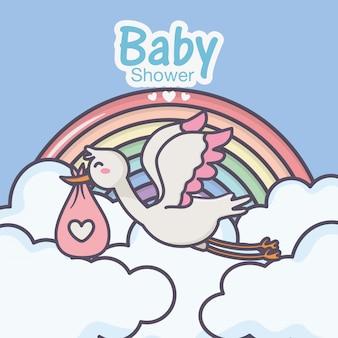 ベビーシャワーコウノトリおむつピンク虹雲