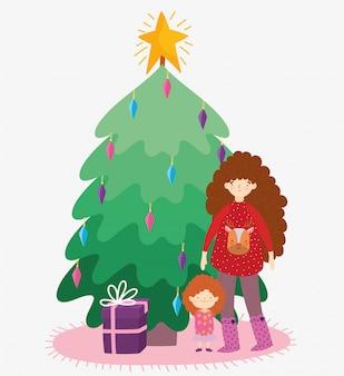 セーターと小さな女の子ツリーギフトメリークリスマス、幸せな新年を持つ女性