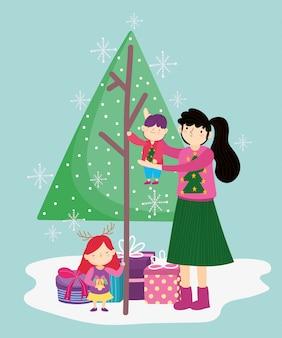 小さな男の子とツリーギフトメリークリスマス、新年あけましておめでとうございますと娘を運ぶ母