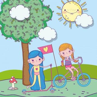 幸せな子供の日、公園で自転車とスクーターに乗っているかわいい女の子