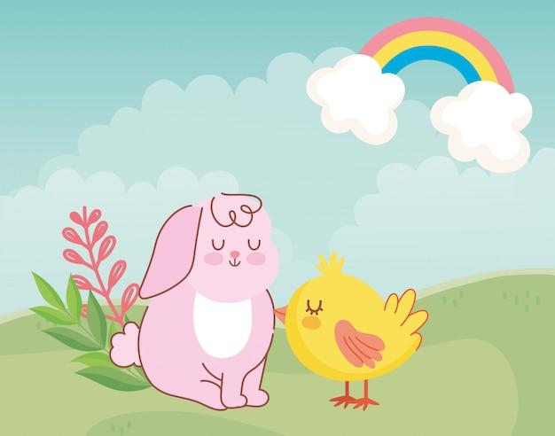 ハッピーイースター、かわいいウサギ、鶏の牧草地に座っています。