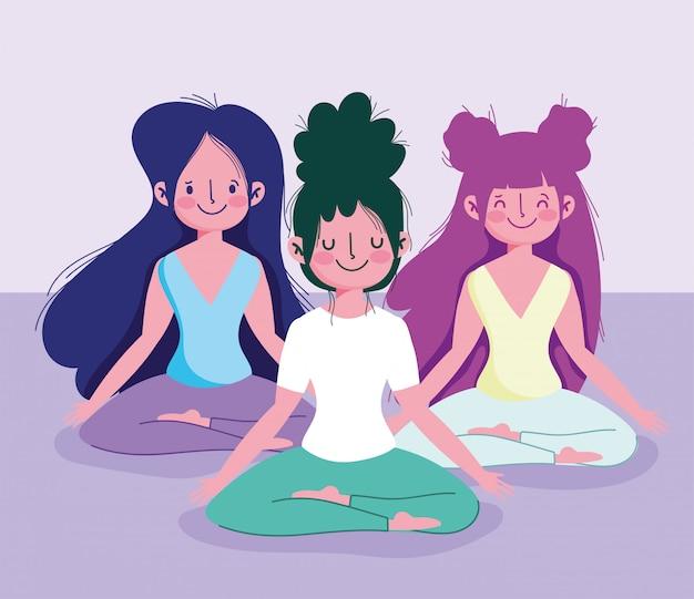 Молодые женщины практикующих йогу позе лотоса спортивные упражнения дома
