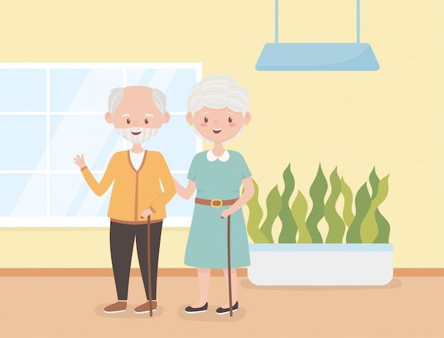 Старики, счастливые бабушка и дедушка вместе в комнате героев мультфильмов