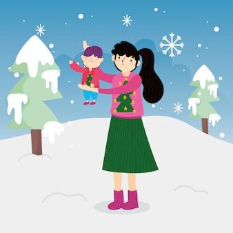 屋外の小さな息子の木雪を運ぶメリークリスマスの母