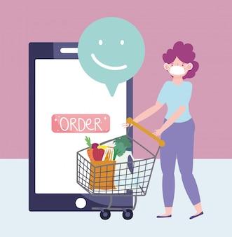 オンライン市場、ショッピングカートの注文を持つ女性、食料品店でのスマートフォンによる食品配達