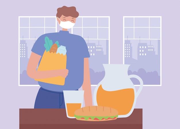 コロナウイルスの社会的距離の予防、食料品の買い物袋を保持しているフェイスマスクを着た男