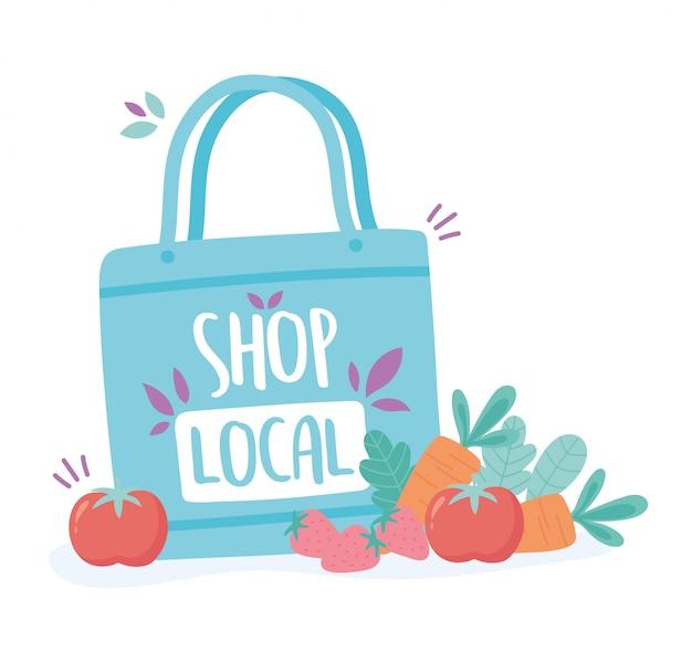 地元のビジネスをサポートし、果物や野菜を入れた小さな市場のエコバッグを買う