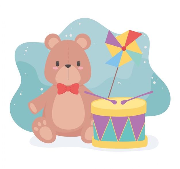 小さな子供が漫画のテディベアのドラムと風車を遊ぶためのおもちゃオブジェクト