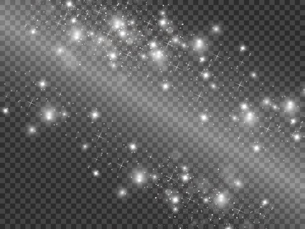 Белые искры и золотые звезды сверкают особым световым эффектом. сверкает на прозрачном фоне. абстрактный узор. сверкающие частицы волшебной пыли