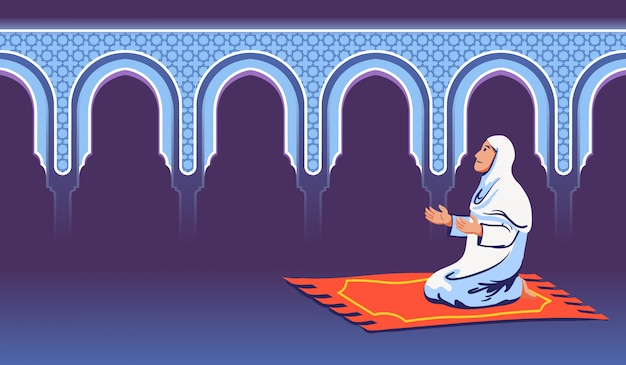 イスラム教徒の女性が座っていると装飾的なモスクの門の近くに祈る。