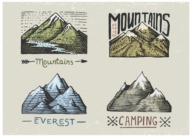 彫刻が施されたヴィンテージ、手描き、古い、ラベル、またはキャンプ、ハイキング、南から北への山頂での狩猟用のバッジのセット