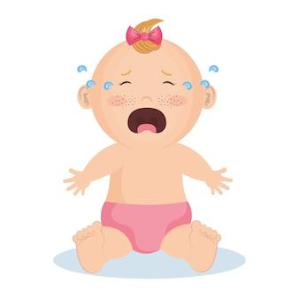 ピンクの弓とおむつを持つ泣いている女の子