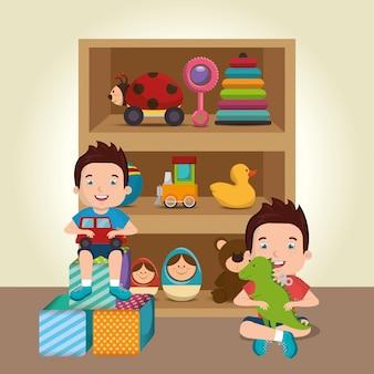小さな男の子がおもちゃのキャラクターで遊ぶ