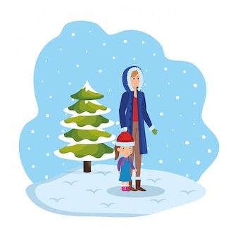 冬の服を着た母と娘、雪景色