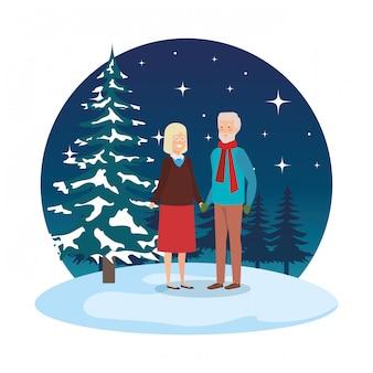 祖父母、冬の服を着た雪景色