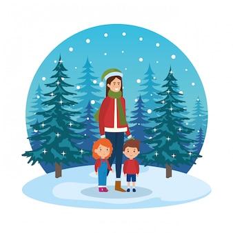 雪景色のクリスマスの服を着た母と子供