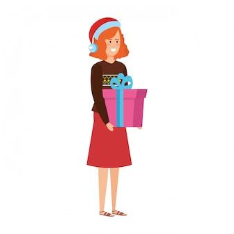 クリスマスの服と贈り物を持つ女性