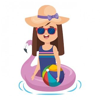 フランドルフロートとビーチのバルーンを持つ少女
