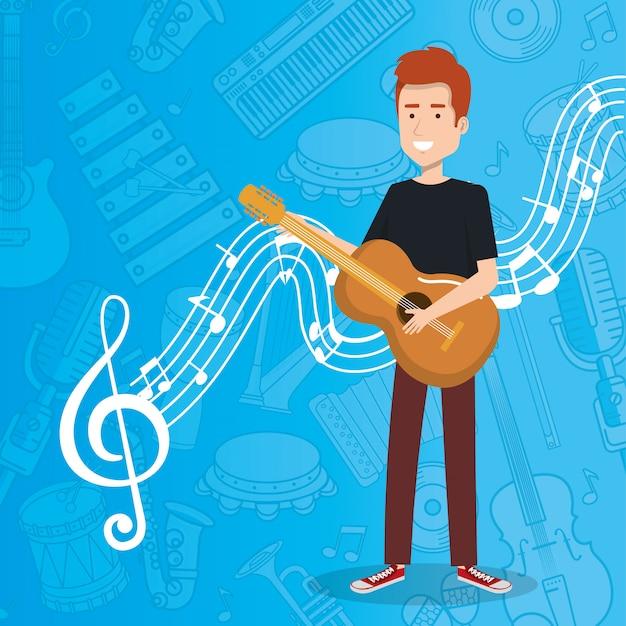 アコースティックギターを弾く男と一緒にライブ音楽祭