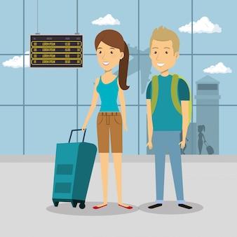 空港でカップル旅行者