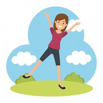 若い女性が公園でスポーツを練習
