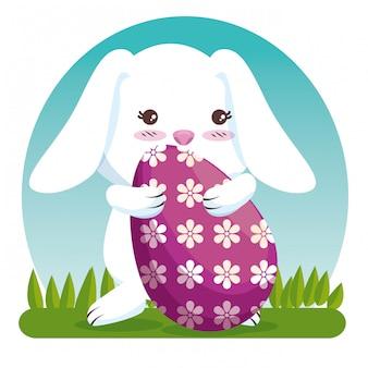 お祝いイベントへの卵の装飾とウサギ