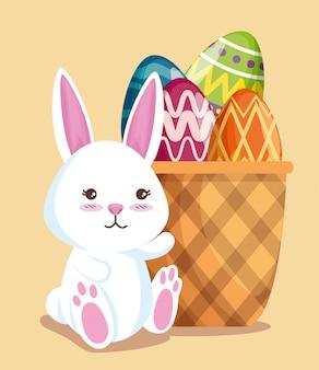 かごの中の卵の装飾と幸せなウサギ