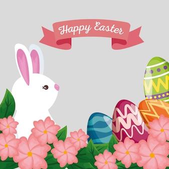 卵の装飾とリボンでかわいいウサギ